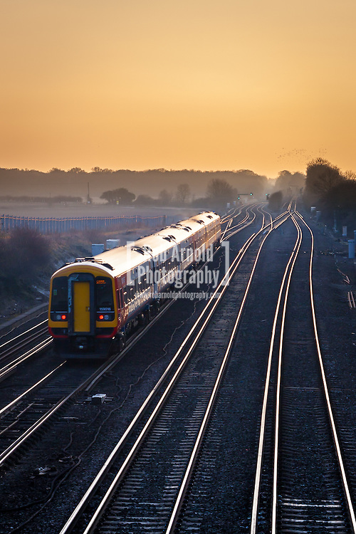 13/03/2013 - A South West Trains service heads into the sunset at Worting Junction in Hampshire. Photo by Rob Arnold