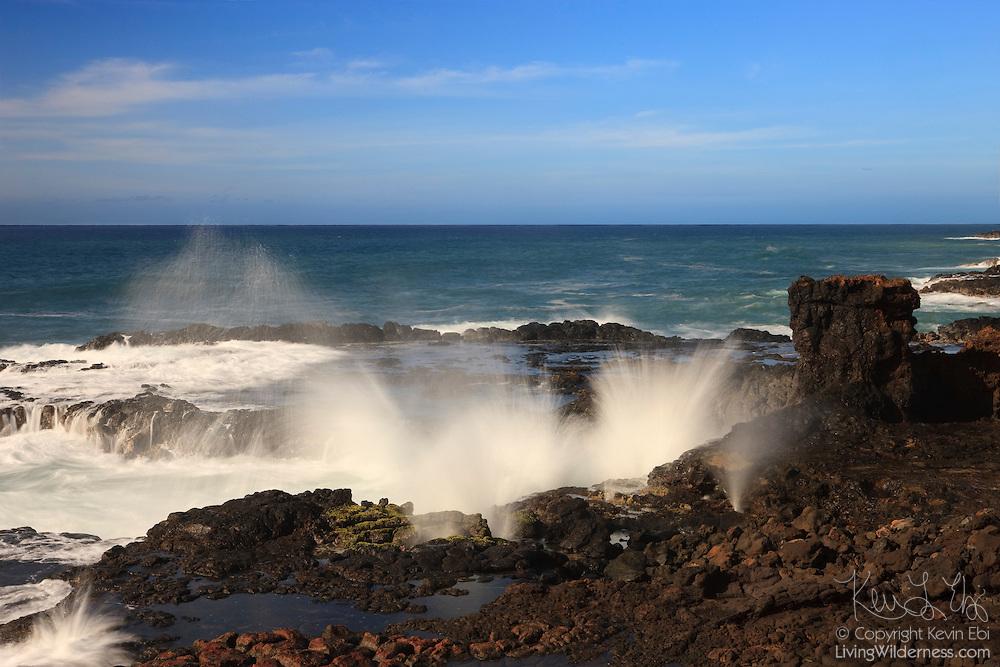 Pacific Ocean waves crash into the rugged coast at Lawa'i Bay in southern Kauai.