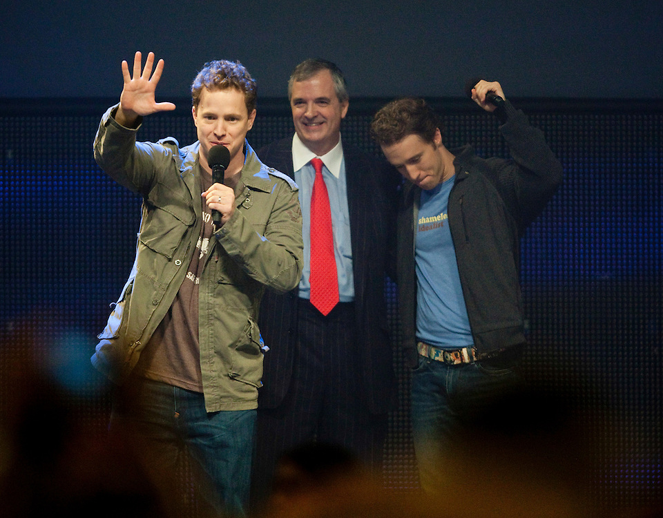 Marc, left, and brother Craig Kielburger, right, co- founders of the charity Free the Children are joined by RIM COO Don Morrison at the charity's We Day celebrations in Kitchener, Ontario, February 17, 2011. We Day was started to celebrate the power of young people. <br /> The Canadian Press/GEOFF ROBINS