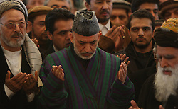 61197469<br /> Afghan president Hamid Karzai (C) prays during funeral ceremony of Afghan Vice President Marshal Mohammad Qasim Fahim, at the Presidential Palace in Kabul, Afghanistan on March 11, 2014. The state funeral service for Afghan First Vice President Marshal Mohammad Qasim Fahim was held amid tight security in the Presidential Palace on Tuesday, 11th March 2014. Picture by  imago / i-Images<br /> UK ONLY
