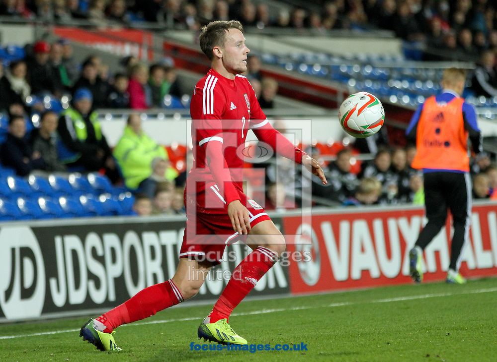 Picture by Tom Smith/Focus Images Ltd 07545141164<br /> 16/11/2013<br /> Chris Gunter of Wales controls the ball with his chest during the International Friendly match at the Cardiff City Stadium, Cardiff.