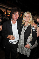 JEFF BECK and his wife SANDRA CASH  at a party to celebrate the publication of 'A Matter of Life and Death' by Ronni Ancona and Alistair McGowan held at Daunt Books, 83 Marylebone High Street, London on 8th October 2009.