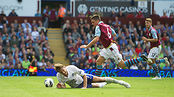 BIRMINGHAM, ENGLAND - Saturday, August 25, 2012: Everton's Nikica Jelavic is fouled by Aston Villa's Ciaran Clark, who was subsequently sent off, during the Premiership match at Villa Park. (Pic by David Rawcliffe/Propaganda)