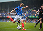 Portsmouth forward Michael Smith with a shot on goal during the Sky Bet League 2 match between Portsmouth and Carlisle United at Fratton Park, Portsmouth, England on 2 April 2016. Photo by Adam Rivers.