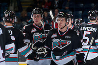 KELOWNA, CANADA - DECEMBER 4: Rourke Chartier #14 and Cole Linaker #26 of Kelowna Rockets celebrate the win against the Medicine Hat Tigers on December 4, 2015 at Prospera Place in Kelowna, British Columbia, Canada.  (Photo by Marissa Baecker/Shoot the Breeze)  *** Local Caption *** Rourke Chartier; Cole Linaker;
