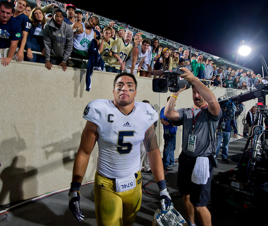 Linebacker Manti Te'o (5) heads into the locker room after the win against MSU.
