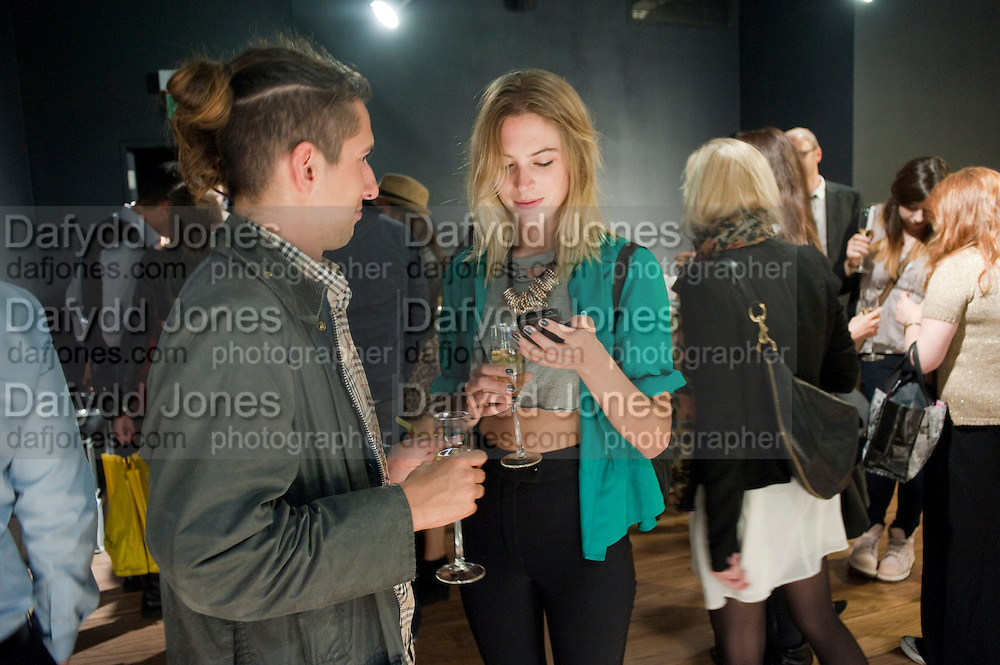 RORY DCS; POLLY BROWN, United Nude launched their London shop.  in association with TANK Magazine. Floral st. Covent Garden. London. 7 September 2011. <br /> <br />  , -DO NOT ARCHIVE-© Copyright Photograph by Dafydd Jones. 248 Clapham Rd. London SW9 0PZ. Tel 0207 820 0771. www.dafjones.com.