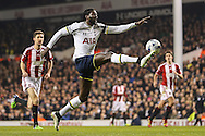 Emmanuel Adebayor of Tottenham Hotspur brings down the ball in the Sheffield United penalty box during the Capital One Cup Semi-Final 1st Leg match between Tottenham Hotspur and Sheffield Utd at White Hart Lane, London, England on 21 January 2015. Photo by David Horn.