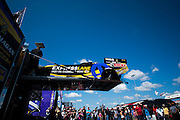 April 22-24, 2016: NHRA 4 Wide Nationals:  An NHRA Funny car is unloaded from a trailer