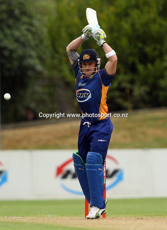 Brendon McCullum watches the ball carefully as he let's it go through.<br /> Twenty20 Cricket - HRV Cup, Otago Volts v Canterbury Wizards, 13 January 2012, University Oval, Dunedin, New Zealand.<br /> Photo: Rob Jefferies/PHOTOSPORT