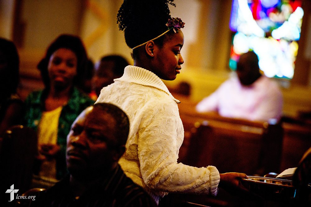 A young parishioner collects the offertory during service at Lutheran Church of the Redeemer, Baltimore, on Palm Sunday, March 25, 2018. LCMS Communications/Erik M. Lunsford