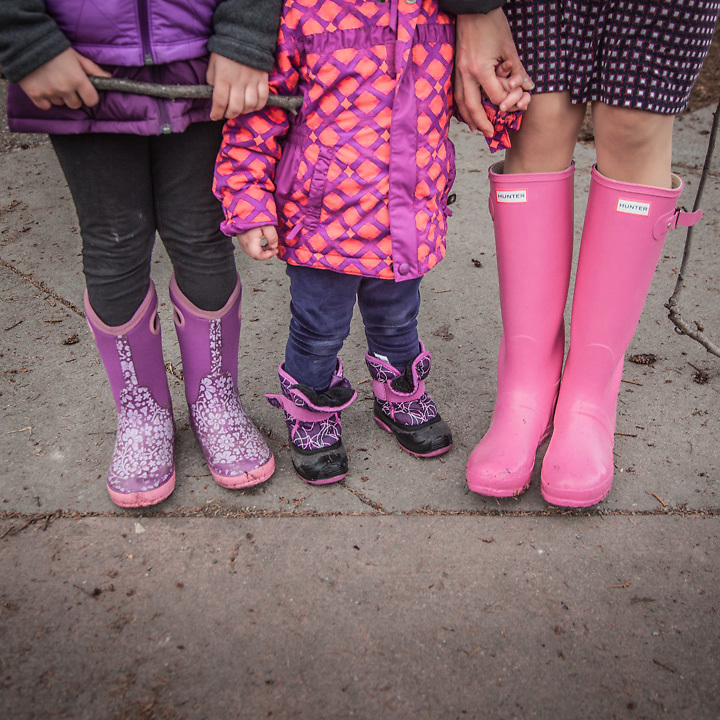 Yuliya Mitchell and her daughters Sonya (6) and Cemma (2) at the corners of 14th Ave. and G Street in Anchorage's South Addition neighborhood
