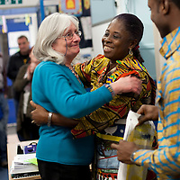 Picture Shows : Head Teacher Moria Brown thanks Madam Juliet Osafo and Ayakwa Kwabena of Juliet Johnson School, Ghana  as they gift  a painting of the bus which Muthill Primary part funded..Muthill Primary School, Muthill by Crieff, Perthshire, Scotland stage an evening of international cooking to celebrate their joint work with a partner school Juliet Johnson School, Ghana which is visiting this week. They have strong links with the Ghanians and have helped to raise money to contribute toward funding a new school bus.   Feature for TESS..Picture Drew Farrell Tel : 07721-735041