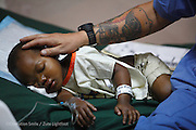 0116, Elisa Havotrinhaina Fifaliana,  Female, 2 years old, UCL, after.  With Recovery Room Nurse Petra Peterson from Sweden.<br /> Tamatave Hospital. Operations Smile's 2014 mission to Tamatave Madagascar. 10th - 20th September 2014<br /> <br /> (Operation Smile Photo - Zute Lightfoot)