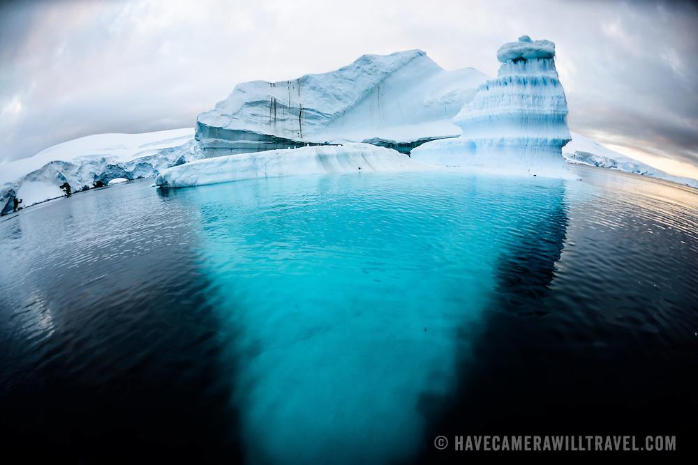 An iceberg floaats in Hughes Bay on the western coast of the Antarctic Peninsula.