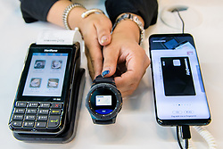 &copy; Licensed to London News Pictures.<br /> 27/06/2017<br /> A demonstration of Samsung Pay Gear being used to make a payment using a Samsung Gear (watch) at The Money 20/20 Europe exhibition held at The Bella Centre in Copenhagen, Denmark,  June 27th 2017<br /> The Money 20/20 Europe exhibition is the largest FinTech event in Europe and show cases new and emerging technologies in the financial sector<br /> Photo credit should read Ant Upton/LNP