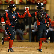 02 March 2018: San Diego State softball closes out day two of the San Diego Classic I at Aztec Softball Stadium with a night cap against CSU Northridge. San Diego State Iesha Hill (24) high fives teammate Janina Jusay (8) as she comes in to pinch run in the bottom of the third. The Aztecs dropped a close game 2-0 to the Matadors. <br /> More game action at sdsuaztecphotos.com