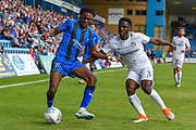 Gillingham FC midfielder Regan Charles-Cook (11) and Coventry City defender Brandon Mason  (3) during the EFL Sky Bet League 1 match between Gillingham and Coventry City at the MEMS Priestfield Stadium, Gillingham, England on 25 August 2018.