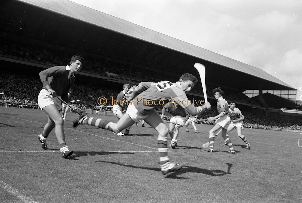 03/09/1967<br /> 09/03/1967<br /> 3 September 1967<br /> All-Ireland Minor Hurling Final: Cork v Wexford at Croke Park, Dublin.<br /> Wexford forward, J. Murphy (15), sends the ball wide with Cork back, M.  McCarthy on the left.