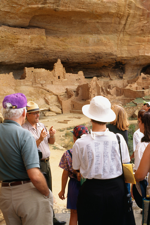 350405-1013 ~ Copyright: George H. H. Huey ~ Visitors at Long House. Second largest Anasazi culture cliff dwelling at Mesa Verde [w/150 rooms and 21 kivas], was occupied from about A.D. 1200-1300, by 150-175 people. Wetherill Mesa. Mesa Verde National Park, Colorado.