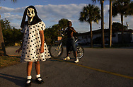 &quot;polka dots with mask&quot;<br /> <br /> Angela Mejier, 6, hides behind a halloween mask while playing outside with friends.