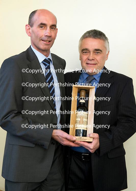 Edrington Achievement Awards....15.12.11<br /> Chief Exec Ian Curle presents an award to Max McFarlane<br /> Picture by Graeme Hart.<br /> Copyright Perthshire Picture Agency<br /> Tel: 01738 623350  Mobile: 07990 594431
