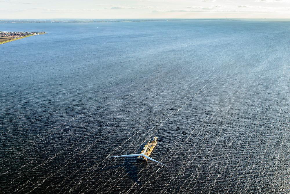Nederland, Flevoland, Noordoostpolder, 28-02-2016; Westermeerdijk, ten noorden van Urk. Bouw van het grootste windmolenpark van Nederland, Windpark Noordoostpolder. De mega windmolens worden zowel op land als in het IJsselmeer gebouwd, in het water de fundamenten. Het windmolenpark van de Koepel Windenergie Noordoostpolder is een initiatief van NOP Agrowind, energiebedrijf RWE/Essent en Westermeerwind. <br /> onstruction of the largest wind farm in the Netherlands, Wind farm Northeast Polder. On land and offshore in IJsselmeer.<br /> luchtfoto (toeslag op standard tarieven);<br /> aerial photo (additional fee required);<br /> copyright foto/photo Siebe Swart