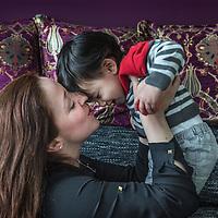 Nederland, Zoetermeer, 31 maart 2016.<br /> Leyla Cakir, sociaal werker en voorzitster van Al Nisa met haar zoontje.<br /> Al Nisa ('de vrouwen') is een vrijwilligersorganisatie voor moslimvrouwen en kinderen en voor vrouwen met interesse voor de islam.<br /> <br /> Foto: Jean-Pierre Jans