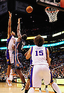 Feb. 4, 2012; Phoenix, AZ, USA; Phoenix Suns guard Josh Childress (1)  puts up a shot against the Charlotte Bobcats forward Bismack Biyombo (0) during the second half at the US Airways Center. The Suns defeated the Bobcats 95 - 89. Mandatory Credit: Jennifer Stewart-US PRESSWIRE.