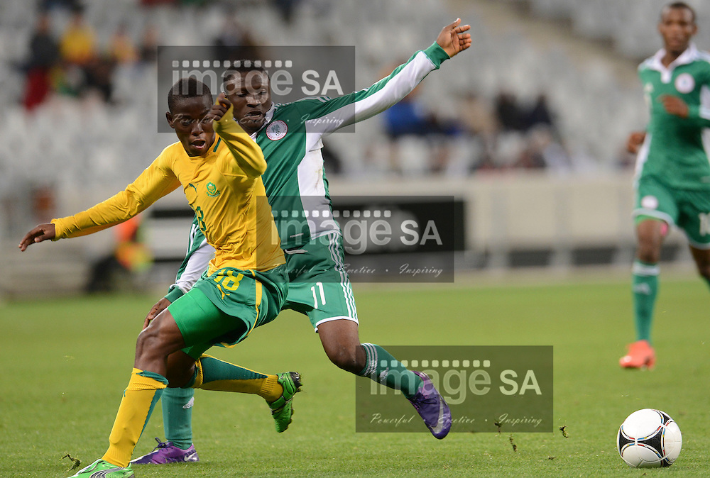 CAPE TOWN, SOUTH AFRICA: Tuesday 29 May 2012, THABANI MTHEMBU of South Africa and AMINU UMAR of Nigeria during the under 20 Cape Town International Soccer Challenge between South Africa and Nigeria at the Cape Town Stadium..Photo by Roger Sedres/ImageSA