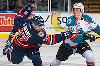 KELOWNA, CANADA - JANUARY 7: Conner Bruggen-Cate #20 of the Kelowna Rockets checks Joe Gatenby #37 of the Kamloops Blazers as he takes a shot on January 7, 2017 at Prospera Place in Kelowna, British Columbia, Canada.  (Photo by Marissa Baecker/Shoot the Breeze)  *** Local Caption ***