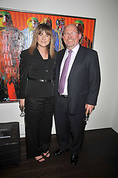 JEANETT EXNER and the Danish Ambassador MR BIRGER RIIS-JORGENSEN at a private view of paintings by Johnny Madsen at Mews 42 Gallery, South Kensington, London on 15th April 2009.