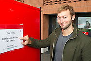 """Swimmer Ian THORPE of Australia points to a placard announcing his press confercene held at the Centro sportivo nazionale della gioventu (""""youth and sports""""-Centre) in Tenero, Switzerland, Wednesday, March 16, 2011. Five-time Olympic gold medallist Ian Thorpe has finalised his coaching set-up ahead of next year's London Olympic Games, announcing today that he will link up with former Australian Institute of Sport Coach and Russian born Gennadi Touretski in Switzerland. (Photo by Patrick B. Kraemer / MAGICPBK)"""