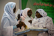 A Sudanese woman has run out of time but still has more to say after the opportunity to speak her mind from the stage while attending the first-ever international Conference on Womens' Challenge in Darfur, gather in a compound belonging to the Govenor of Noth Darfur in Al Fasher (also spelled, Al-Fashir) where the women from remote parts of Sudan gathered to discuss peace and political issues. Another 'sister' tries to grab her mic for their own chance to speak amid shouting and frustration at the lack of further time.