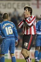 Photo: Leigh Quinnell.<br /> Reading v Southampton. Coca Cola Championship. 10/02/2006. Southamptons Grzegorz Rasiak sees his shot go wide.
