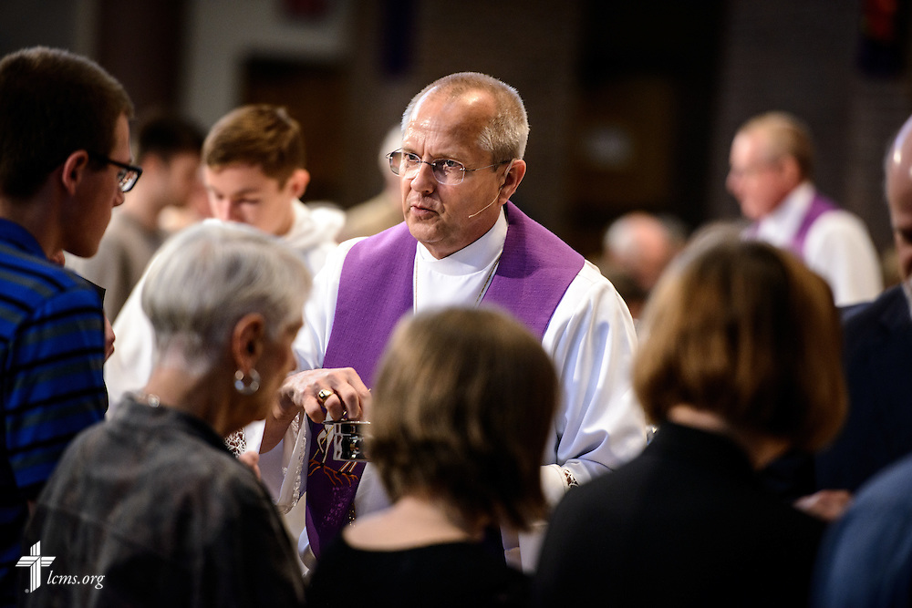 The Rev. Wally Arp, senior pastor of St. Luke's Lutheran Church, distributes the Sacrament during communion at the church on Sunday, March 6, 2016, in Oviedo, Fla. LCMS Communications/Erik M. Lunsford