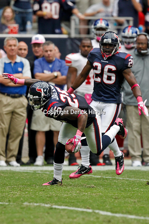October 10, 2010; Houston, TX USA; Houston Texans defensive back Kareem Jackson (25) runs back an interception against the New York Giants during the second half at Reliant Stadium. The Giants defeated the Texans 34-10. Mandatory Credit: Derick E. Hingle