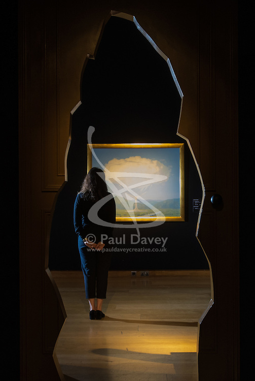 Christie's, London, February 24th 2017. Fine art auctioneers Christie's hold a press preview for their Impressionist and Modern Art and Art of the Surreal sale which takes place on 28th February. PICTURED: A woman admires René Magritte's La corde sensible (1960) valued between £14-18 million.