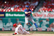 ST. LOUIS, MO - MAY 16: Daniel Murphy #28 of the New York Mets turns a double play over Carlos Beltran #3 of the St. Louis Cardinals during the game at Busch Stadium on May 16, 2013 in St. Louis, Missouri. The Mets won 5-2. (Photo by Joe Robbins)