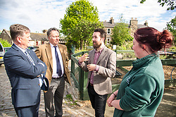 Pictured: Keith Brown,  George Elliis, Josiah Lockhart and Maia Gordon<br /> <br /> Cabinet Secretary for Economy, Jobs & Fair Work Keith Brown visited Gorgie City Farm today  to mark their accreditation as the 800th Living Wage employer in Scotland. Mr Brown met Josiah Lockhart, CEO and undertook a short tour of the farm, celebrating their accreditation and promoting the Living Wage more generally. The Scottish Government has set a target of reaching 1,000 Scottish-based Living Wage Accredited Employers by autumn 2017. While at the farm Mr Brown met Maia Gordon, Kirsty McGoff (17) and Zoe White (18), who have benefited from the living wage, and George Ellis, chair of the farm's board of directors<br /> Ger Harley | EEm 18 May 2017