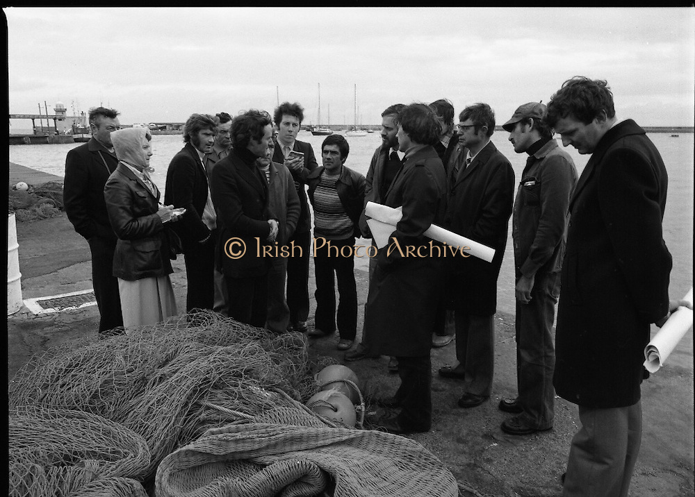 French Fishermen At Howth.   (M27).<br /> 16.10.1978.<br /> 10.16.1978.<br /> 16th October 1978.<br /> B.I.M.(Bord Iascaigh Mhara),The Irish Fisheries Board,invited a group of French fishermen to visit the facilities at Howth, Dublin. The fishermen took in a tour of IC Trawl Ltd and the West Pier on their visit.<br /> The French fishermen and officials fron BIM are pictured discussing fishing on the quay wall in Howth harbour.