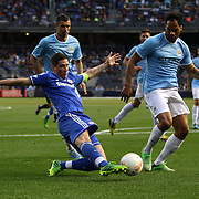Fernando Torres, Chelsea, crosses past Joleon Lescott, Manchester City, in action during the Manchester City V Chelsea friendly exhibition match at Yankee Stadium, The Bronx, New York. Manchester City won the match 5-3. New York. USA. 25th May 2012. Photo Tim Clayton