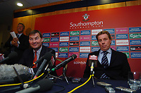 New Southampton Manager Harry Redknapp (right) faces the press with chairman Rupert Lowe and , in the backgrounf, his agent Dennis Roach, 8/12/2004. Credit Back Page Images / Matthew Impey