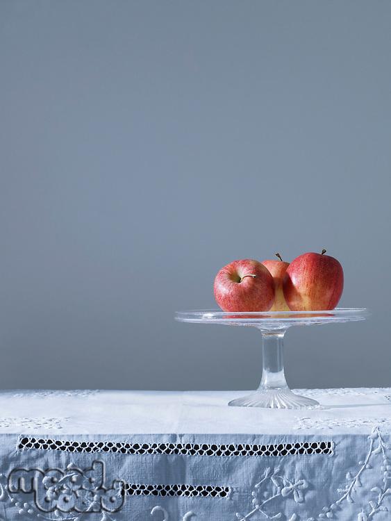 Three apples on fruit platter on table