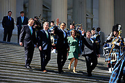 Speaker Nancy Pelosi and the 44th President of the United States, Barack Obama, join at the stairs of the US Capitol on St. Patricks Day after securing the Obamacare bill.