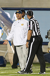 BERKELEY, CA - OCTOBER 06: Head coach Jeff Tedford of the California Golden Bears argues a call with side judge Ryan Dickson on the sidelines against the UCLA Bruins during the fourth quarter at California Memorial Stadium on October 6, 2012 in Berkeley, California. The California Golden Bears defeated the UCLA Bruins 43-17. (Photo by Jason O. Watson/Getty Images) *** Local Caption *** Jeff Tedford; Ryan Dickson
