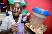 A boy drinks water from a filter in his home. Northern Ghana, Thursday November 13, 2008.