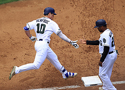 May 29, 2017 - San Diego, CA, USA - San Diego Padres' Hunter Renfroe high fives first base coach Johnny Washington after hitting a grand slam in the fourth inning against the Chicago Cubs on Monday, May 29, 2017 at Petco Park in San Diego, Calif. (Credit Image: © K.C. Alfred/TNS via ZUMA Wire)