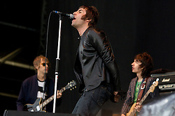 © licensed to London News Pictures . 30/06/2012 . Manchester , UK . Beady Eye , fronted by Liam Gallagher with fellow bandmates Andy Bell (left) and Gem Archer (right), perform on stage at Heaton Park as warm up for the Stone Roses , who are on their comeback tour . Photo credit : Joel Goodman/LNP