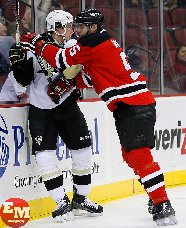 Dec 10, 2008; Newark, NJ, USA; New Jersey Devils defenseman Colin White (5) hits Pittsburgh Penguins center Sidney Crosby (87) during the first period at the Prudential Center.